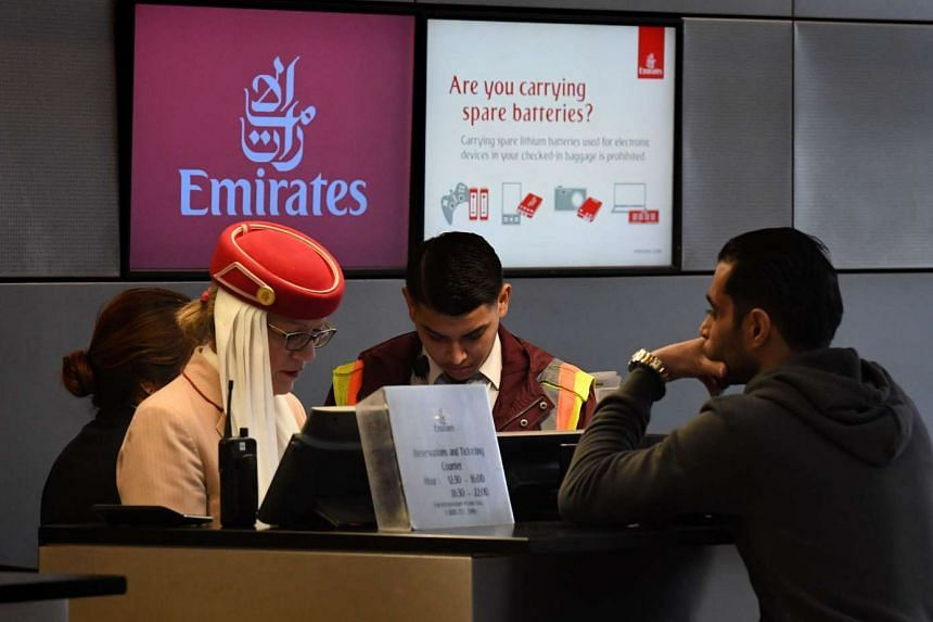 A passenger buying a ticket at a Emirates Airline counter in Los Angeles, California, on March 21, 2017.