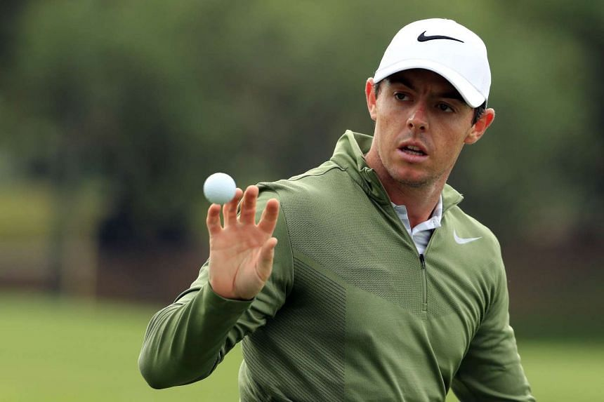 Woodland conceded his second round group game with McIlroy (above) for personal reasons.