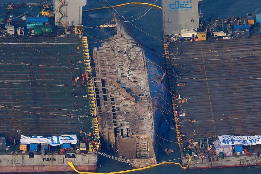 The sunken ferry Sewol is seen during its salvage operations at the sea off Jindo, South Korea, on March 23, 2017.