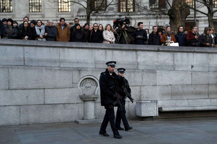 Armed police officers patrolling at a vigil in Trafalgar Square the day after an attack, in London, Britain, on March 23, 2017.
