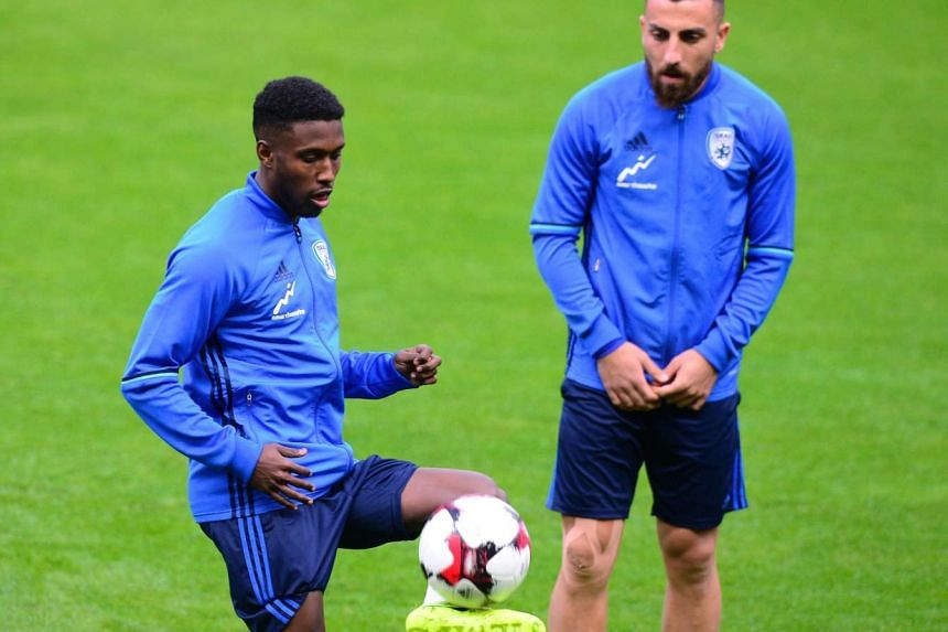 Israel's defender Taleb Tawatha (left) plays with a ball during a training session at the Molinon stadium in Gijon, on March 23, 2017 on the eve of the World Cup 2018 European qualifying football match Spain vs Israel.