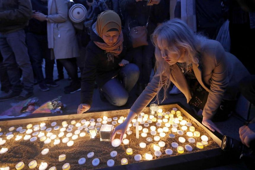 People light candles at a vigil in Trafalgar Square the day after an attack, in London, Britain March 23, 2017.