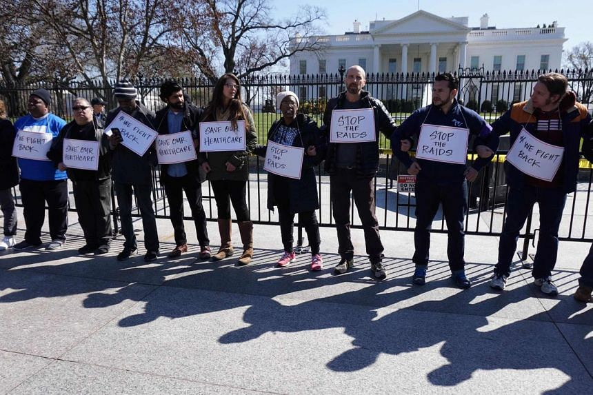 Protestors take part in a demonstration on health care on March 23, 2017 in Washington, DC.