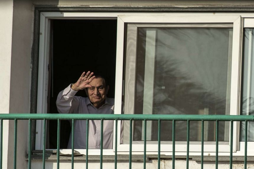 Egypt's former president Hosni Mubarak waving to people from his room at the Maadi military hospital in Cairo on Oct 6, 2016.