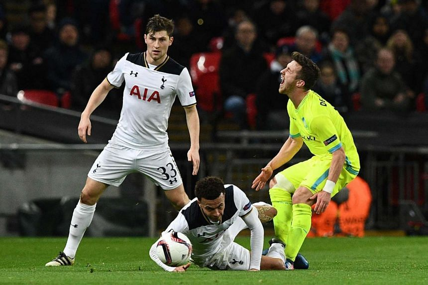 Tottenham Hotspur's English midfielder Dele Alli (centre) challenges Gent's Belgian midfielder Brecht Dejaegere (right) and earns a straight red card sending off at Wembley Stadium in north London, on Feb 23, 2017.