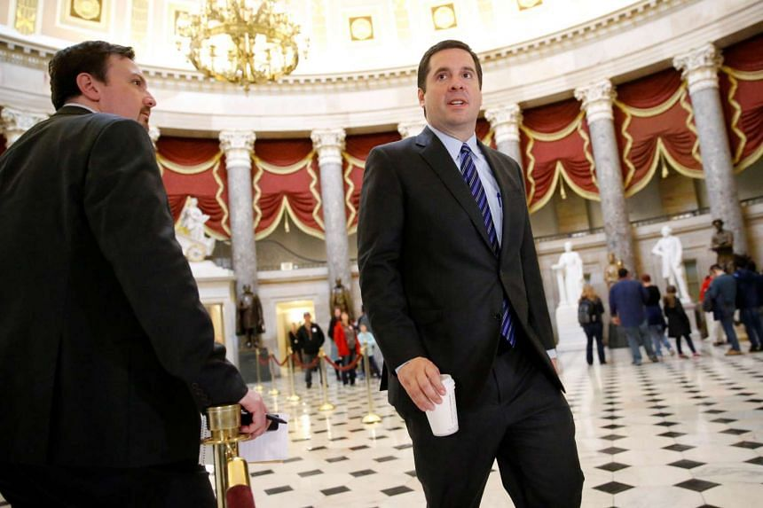 Devin Nunes crosses paths with reporters as he departs Speaker Paul Ryan's office at the US Capitol, March 24, 2017.