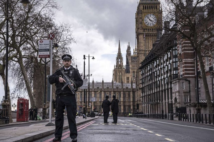 Police secure the area around the Parliament of Great Britain in London, March 22, 2017.