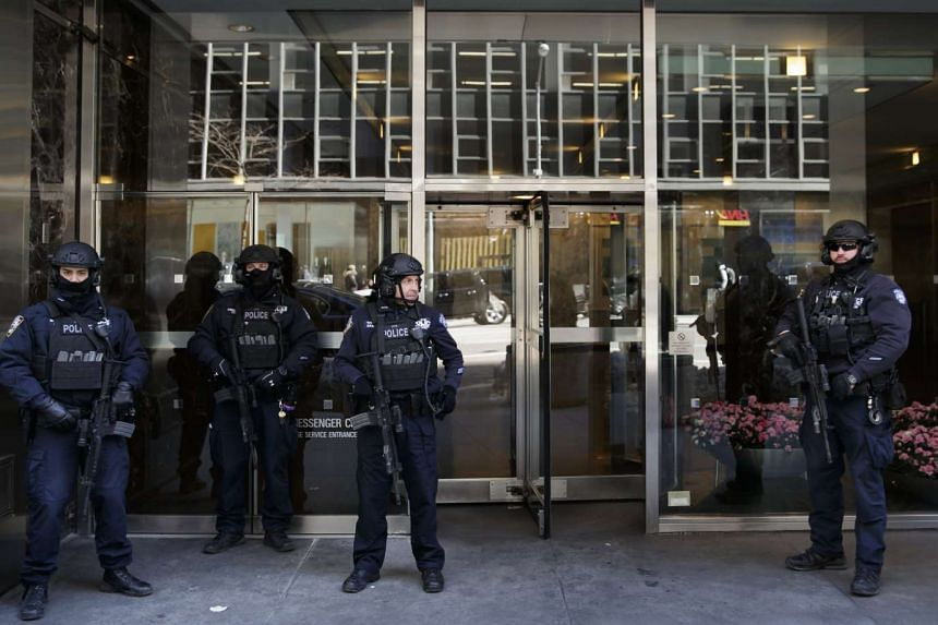 Members of the New York City Police Department's Counterterrorism Bureau stand guard in front of the building housing the British Consulate General in New York on March 23, 2017.