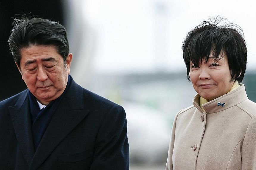 Prime Minister Shinzo Abe (pictured above with his wife Akie)