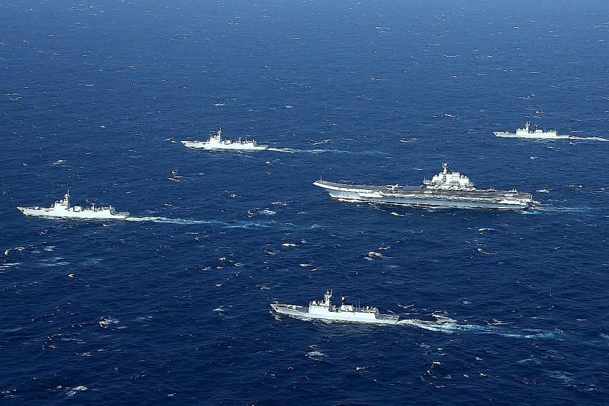 A Chinese navy formation, with aircraft carrier Liaoning, on a January drill in the South China Sea. China, the Philippines, Vietnam, Malaysia, Brunei and Taiwan have claims on the sea.