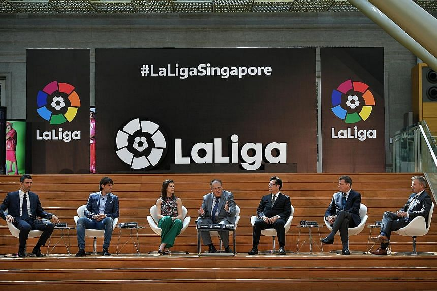 LaLiga president Javier Tebas (middle) speaking at a press conference to announce the opening of their new office in Singapore. The Spanish league is hoping to appeal to Asian audiences more attuned to EPL.
