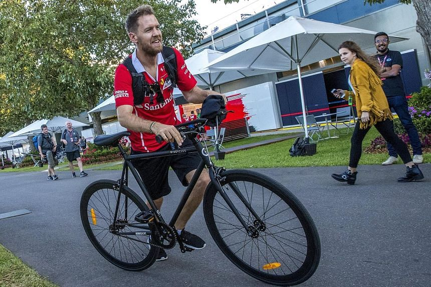 Sebastian Vettel on two wheels at Melbourne's Albert Park circuit. He will switch to the four wheels of Ferrari's race car to compete with Mercedes for honours.