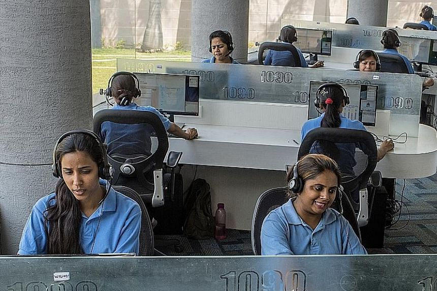 Staff at a police call centre in Lucknow, India, where women have been calling in to complain of persistent calls from strange men. The rise in mobile phone use has made it easier for men from traditional societies to contact women.