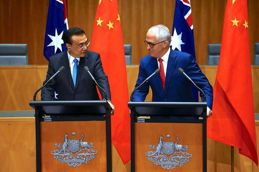 Australia's Prime Minister Malcolm Turnbull (right) and Chinese Premier Li Keqiang attending a press conference at Parliament House in Canberra, on March 24, 2017.