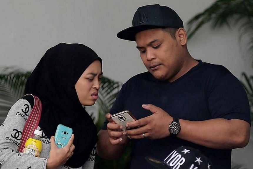 Siti Norhaizah Abdullah (left) was sentenced to six weeks' jail and Rahmat Jumari (right) was sentenced to nine months' jail for causing hurt to Muhammad Abdul Latip.