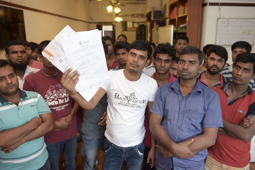 These Bangladeshi construction workers complained this year that their employer did not pay them. Two NGOs have flagged wages as a problem such workers face. There are about 160,000 Bangladeshi workers here, mostly in the construction, shipyard and c