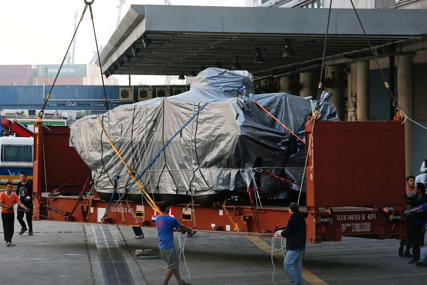 A Terrex armoured vehicle belonging to Singapore being loaded onto a truck at a cargo terminal in Hong Kong on Jan 26, 2017.
