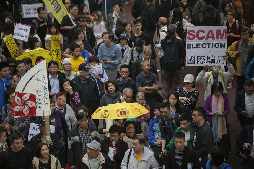 Protestors march through the streets on the eve of the Hong Kong Chief Executive election, in Hong Kong, China on March 25, 2017.