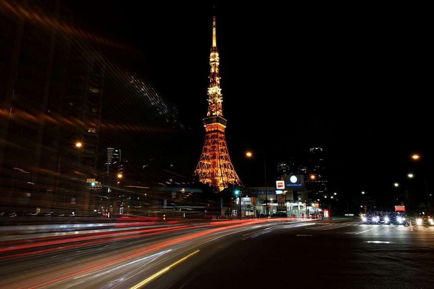 The Tokyo Tower is seen illuminated minutes before Earth Hour in Tokyo, Japan on March 25, 2017.