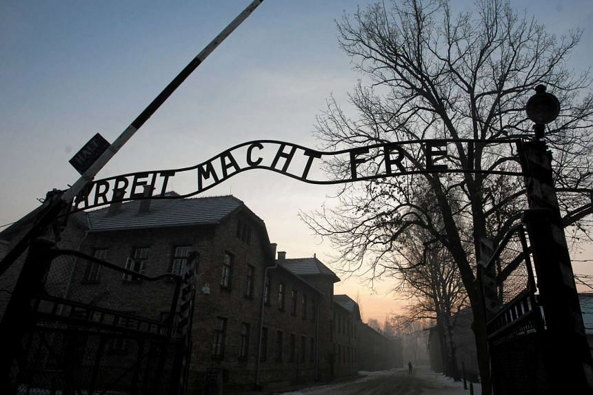 "The Nazi slogan ""Arbeit macht frei"" (Work sets you free) is pictured at the gates of the former concentration and extermination camp."