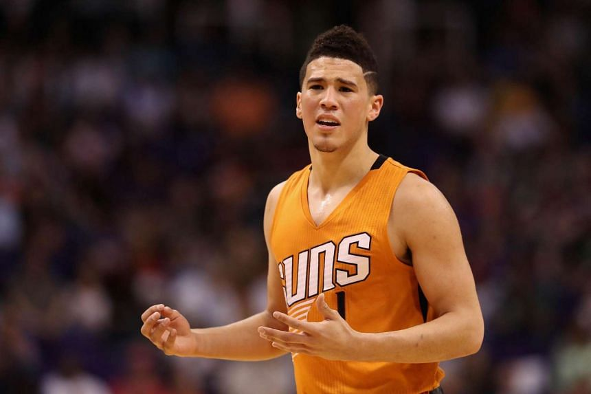 Devin Booker #1 of the Phoenix Suns reacting to a call during the first half of the NBA game against the Portland Trail Blazers, on March 12, 2017.