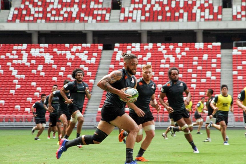 Sunwolves player Derek Carpenter (foreground) training at National Stadium ahead of Super Rugby match against Stormers.