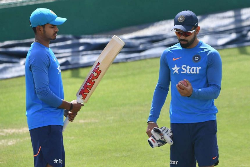 India's Shreyas Iyer (left) speaking with captain Virat Kohli during a training session before the cricket Test match against Australia at The Himachal Pradesh Cricket Association Stadium in Dharamsala, on March 24, 2017.