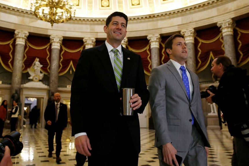 Paul Ryan (centre) walks to the House floor for the opening of a morning session as Congress considers health-care legislation to repeal Obamacare.