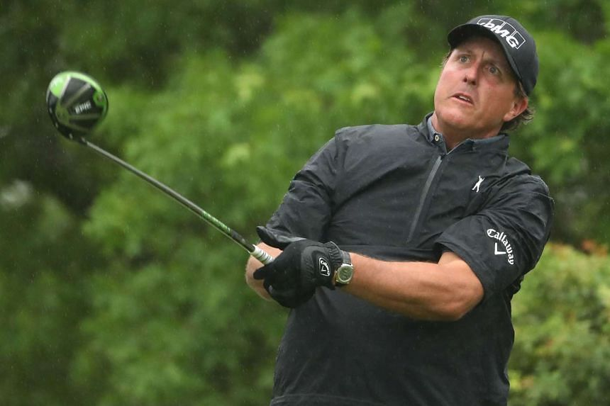 Phil Mickelson tees off on the 6th hole of his match during round three.
