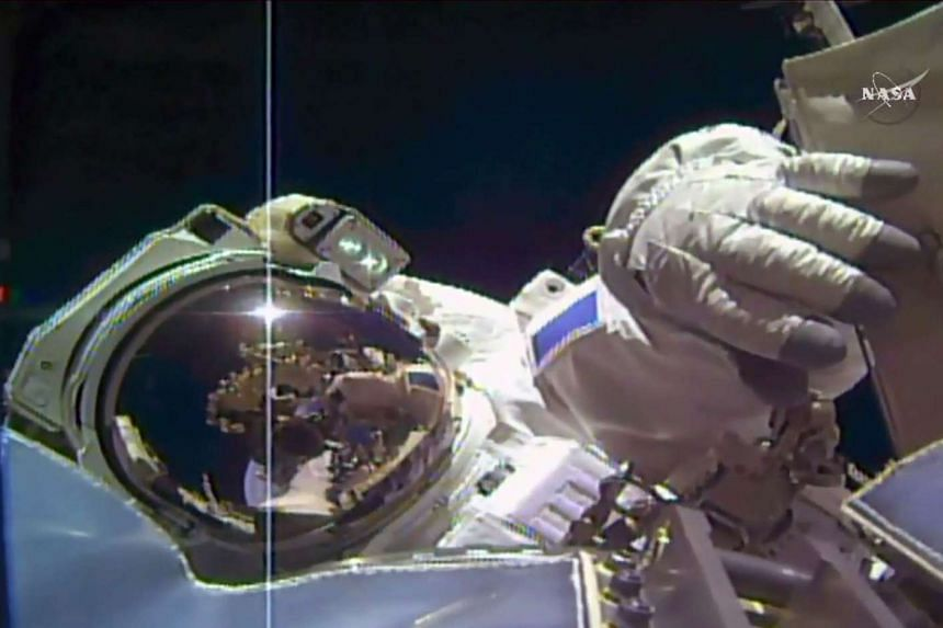 A Nasa TV framegrab shows ESA astronaut Thomas Pesquet working outside the space station on March 24, 2017.