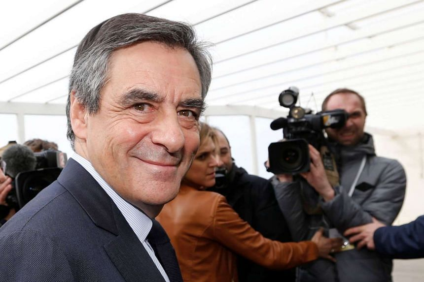 Francois Fillon arrives with supporters before a campaign rally in Biarritz, March 24, 2017.