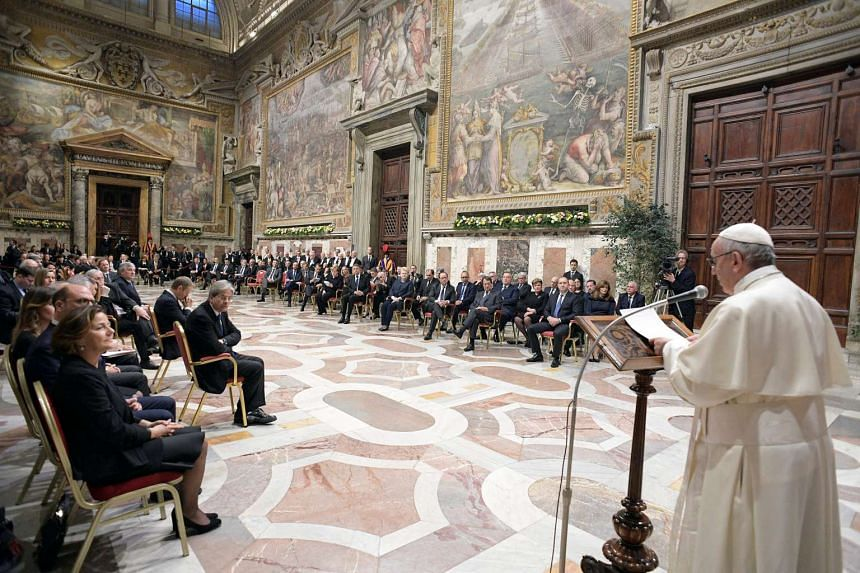 Pope Francis speaks during a meeting with EU leaders at the Vatican, March 24, 2017.