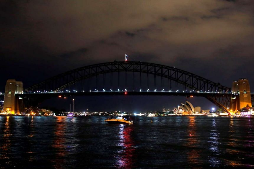 The Sydney Harbour Bridge seen during the tenth anniversary of Earth Hour in Sydney, Australia on March 25, 2017.