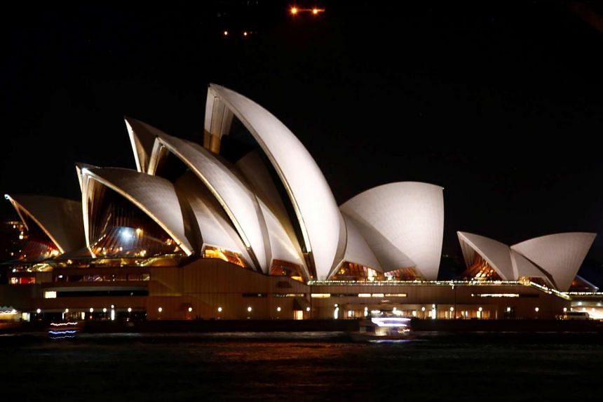 The Sydney Opera House seen before the tenth anniversary of Earth Hour in Sydney, Australia on March 25, 2017.