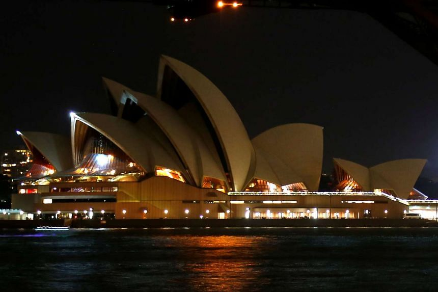 The Sydney Opera House seen during the tenth anniversary of Earth Hour in Sydney, Australia on March 25, 2017.