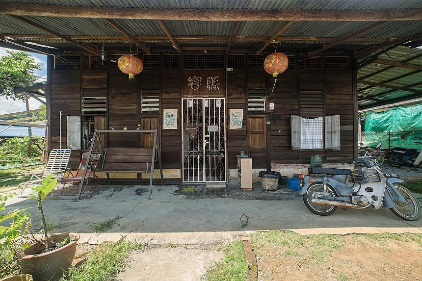 Tourists enjoying the outdoors at Ikan Kurau Homestay (left). Ms Saloma, seen at top with her father and brother, started organising tours in Kampung Sadir, which became a hit, drawing visitors keen for a slice of village life, such as helping to pre