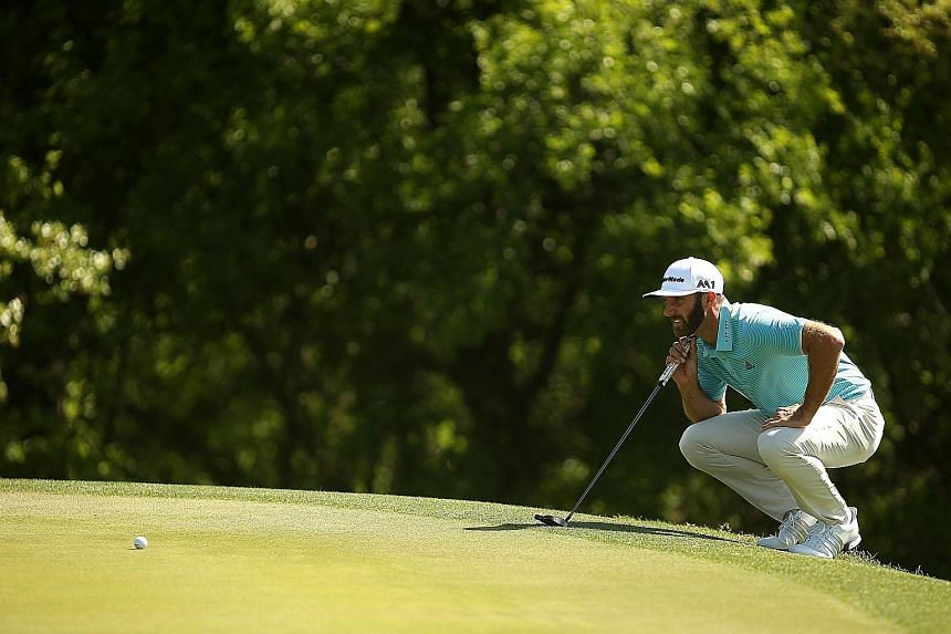 Dustin Johnson lining up a putt during the WGC-Dell Matchplay at the Austin Country Club in Texas on Thursday. The US golfer is aiming to become the first man since 2014 to win three successive events on Tour.