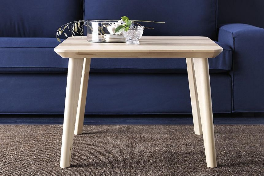 The Lisabo side table (above) uses the wedge dowel concept - threads are carved into the top part of the table leg, which is then slotted into the pre-cut hole in the underside of the table and tightened.