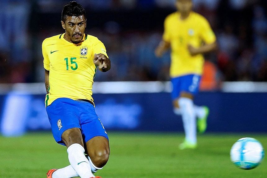 Paulinho scoring the first of his three goals in Brazil's 4-1 victory in the World Cup qualifier against Uruguay. It was the first hat-trick of his professional career.