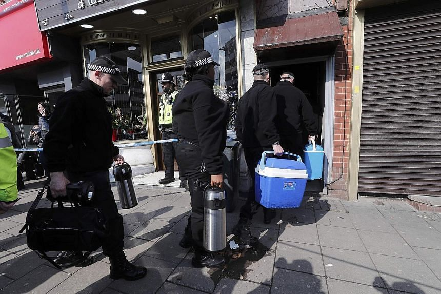 Police officers raiding a property in Birmingham on Thursday after the terror attack in London which killed four and injured up to 50.