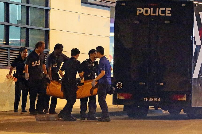 The body of Mr Ang, a Malaysian believed to be a commuter who fell from the LRT platform at Fajar station, being moved yesterday morning. Police are investigating the unnatural death.