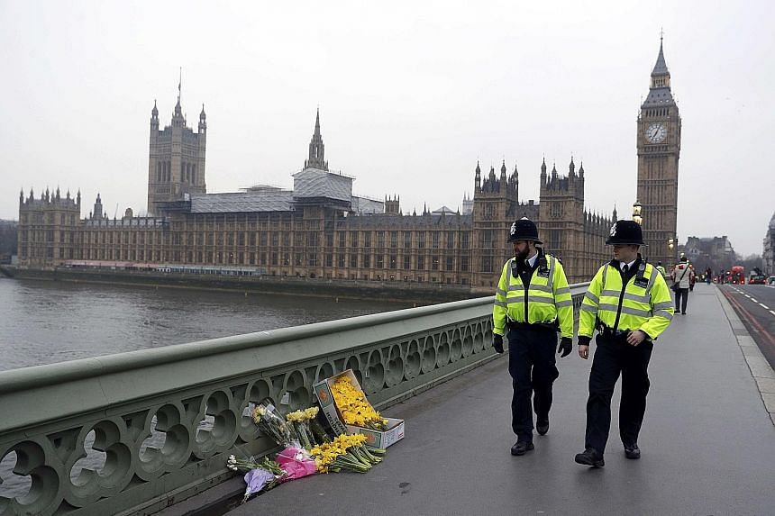 Police patrolling Westminster Bridge in London yesterday. It was the scene of a deadly terror attack on Wednesday.