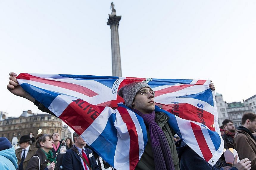 """People at a vigil in Trafalgar Square on Thursday for victims of the terror attack in London. The city's Mayor Khan led the tributes in the heavily policed square, vowing that """"Londoners will never be cowed by terrorism""""."""