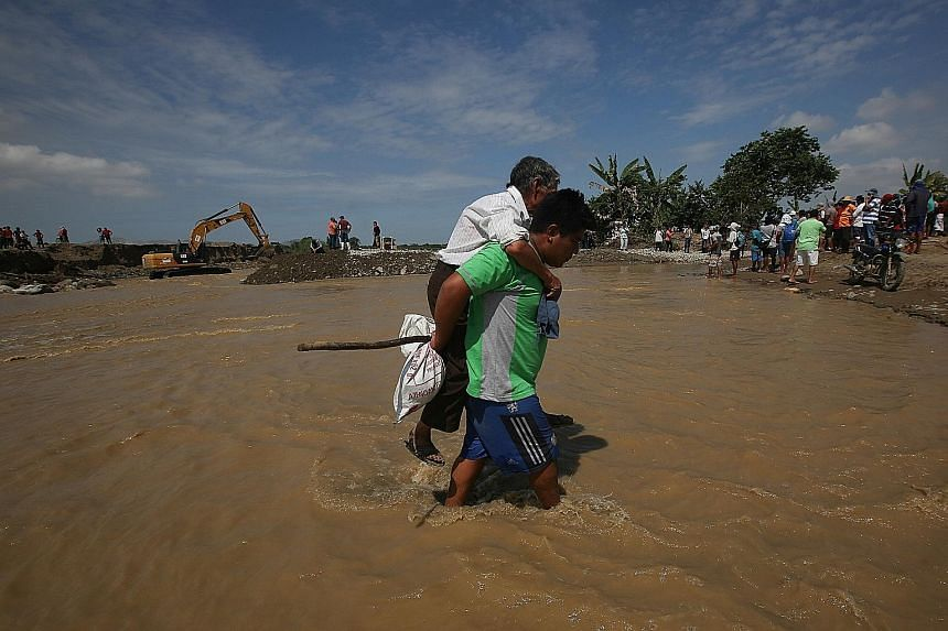 Poor people who built their homes on land near rivers and ravines have been the hardest hit by the worst flooding to hit Peru in decades. Cement columns and parts of brick walls steeped in mud are all that is left of homes that once bordered the Rima