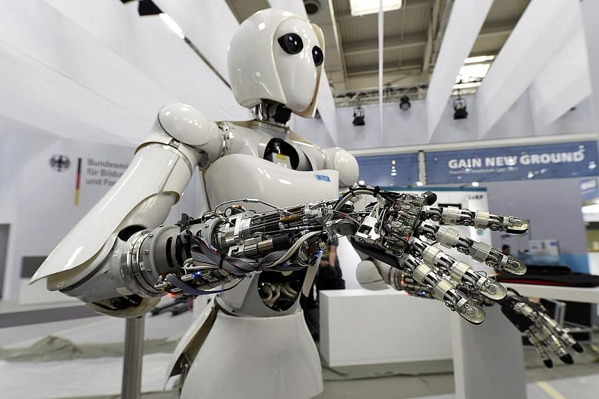A robot on display at a computer fair in Germany. While jobs may be under threat, automation will also bring about benefits and a study by PwC makes a case for lifelong learning so that no one has to lose out.