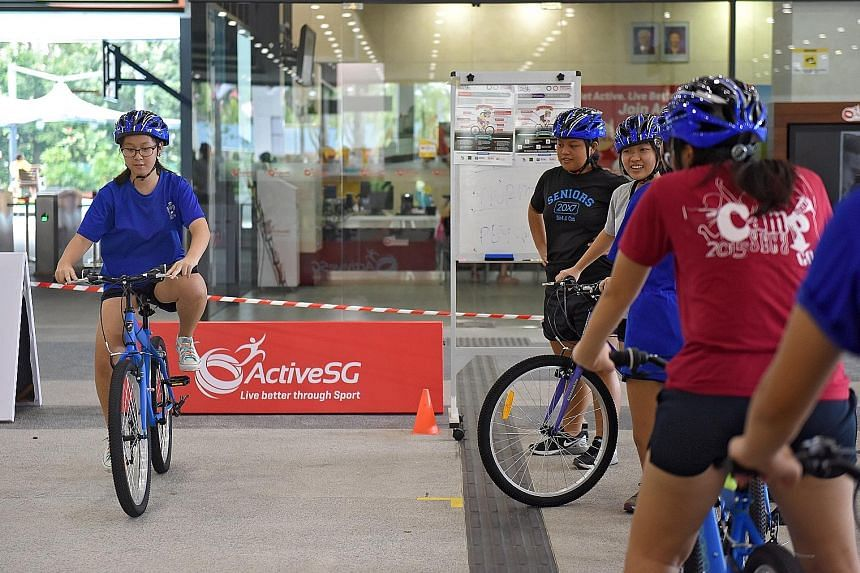 The six-hour Learn-to-Cycle course focused on how to ride a bike around a circuit. Participants were given a safety briefing and taught how to properly put on equipment, such as helmets and knee pads. St Anthony's Canossian Secondary students taking