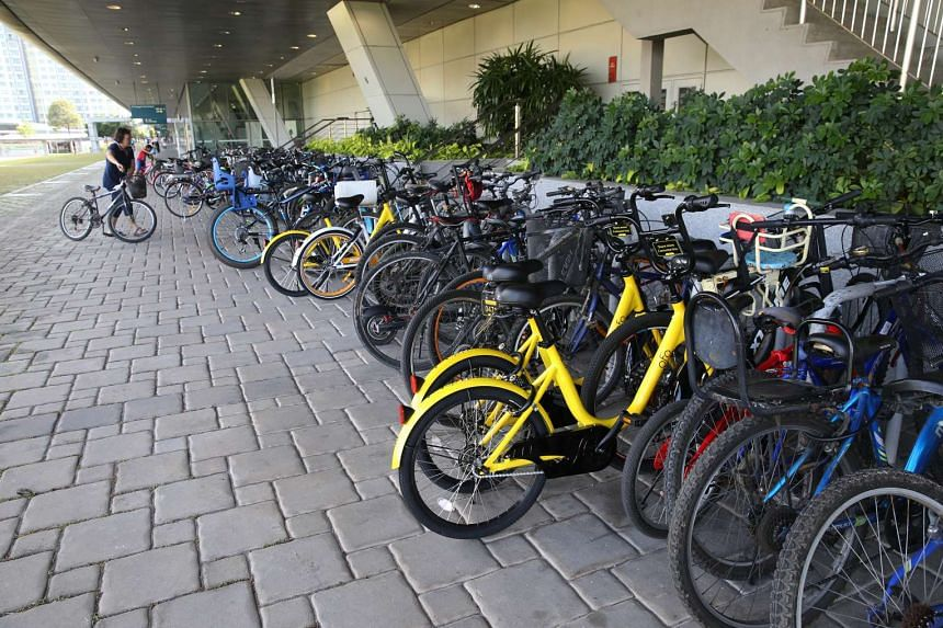 Chinese company ofo's bright yellow bicycles outside Punggol MRT station.