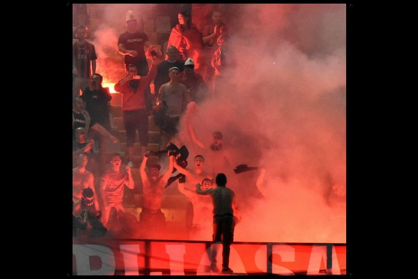 Albanian supporters lighting flares during the Fifa World Cup 2018 qualifier between Italy and Albania.
