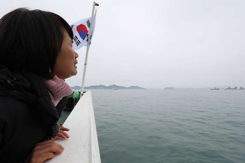 The salvage of the Sewol, which was recovered and sailed away yesterday, has been a key demand of the victims' family members, such as Ms Park Eun Mi, whose teenage daughter Huh Da Yoon's body has never been found.