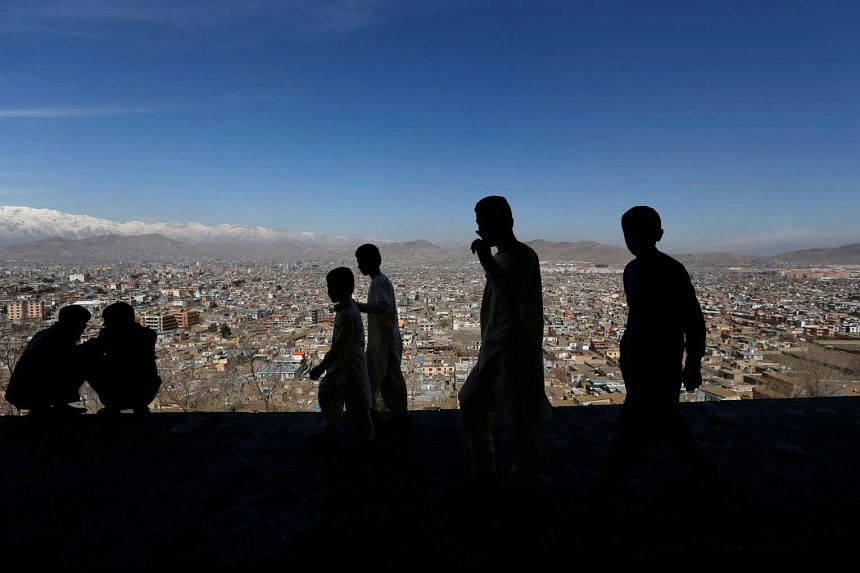 Boys walk on a hilltop during Afghan spring and new year celebrations in Kabul.